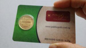Dinar emas 24k Public Gold di'seal' bersama sijil ketulenan.